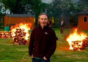 Barry in front of large fires